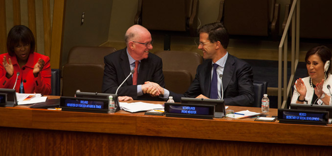 Charles Flanagan, left of center, Minister for Foreign Affairs and Trade, Ireland, shakes hands with Mark Rutte, right of center, Prime Minister of the Netherlands, at the Delivering Zero Hunger, at the United Nations in New York, U.S., on Thursday, September 25, 2014.  Photograph by Michael Nagle